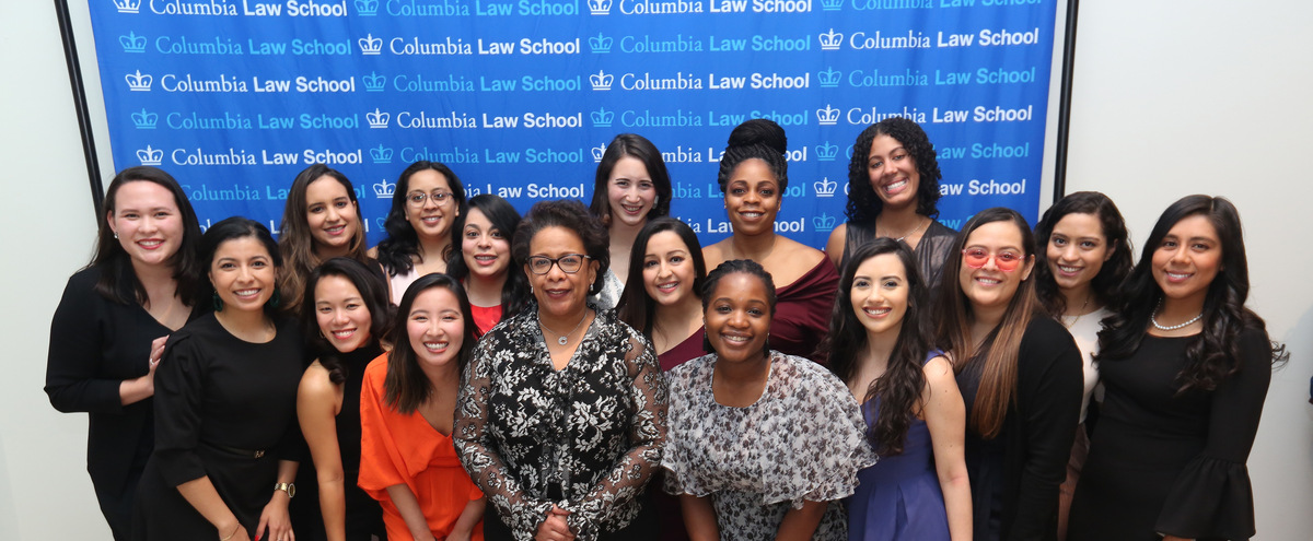 Former U.S. Attorney General Loretta Lynch poses with smiling students at the Gala.