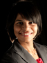 Headshot of Aarthi Anand in a suit