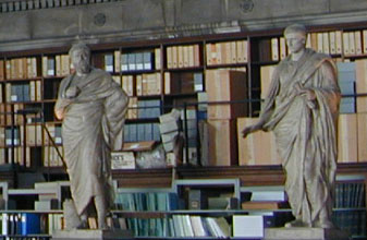 Photo of two statues and law books
