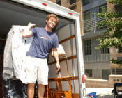 Photo of a student in a moving truck.