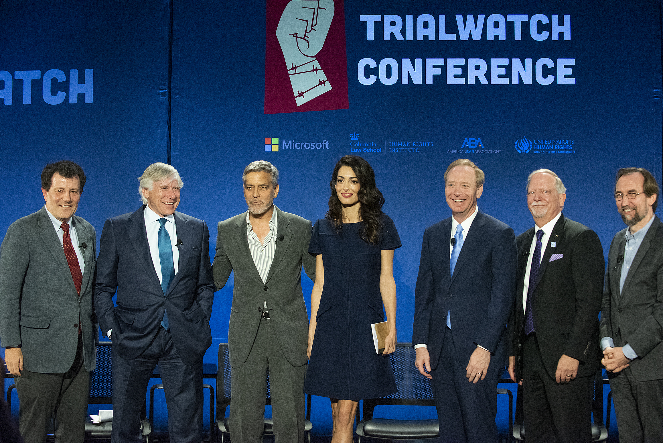 """From left: """"New York Times"""" op-ed columnist Nicholas Kristof, Columbia University President Lee C. Bollinger '71, Clooney Foundation for Justice Co-Presidents George and Amal Clooney, Microsoft President Brad Smith '84, American Bar Association President Bob Carlson, and former United Nations High Commissioner for Human Rights Zeid Ra'ad al-Hussein. Photo: Beatrice Moritz / Clooney Foundation for Justice"""