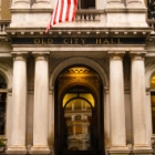Entrance of Old City Hall with an Amerian Flag